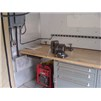 EISU Workshop showing wooden workbench top, cabinets and 5.5kw generator