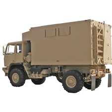 Shop Van Shelter mounted on FMTV in tan
